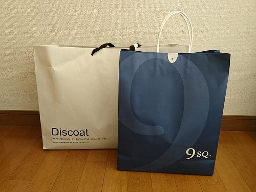 Discoatと9SQ.のショップの紙袋